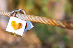 Padlock for love The closed white padlock with heart Stock Photos