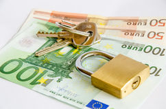 Padlock lying on Euro bank notes Stock Images