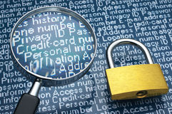 Padlock and magnifier. Stock Photo