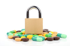 Padlock and medicine Stock Photo