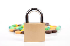 Padlock and medicine Stock Photos