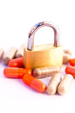 Padlock and medicine Royalty Free Stock Images