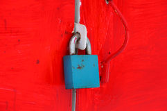 Padlock on a metal cabinet in red Royalty Free Stock Photo