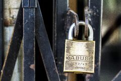 Padlock on metal door Royalty Free Stock Photos