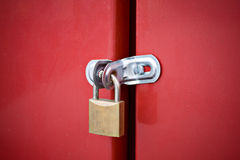 Padlock on metal door lock Royalty Free Stock Images