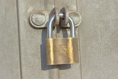 Padlock on metal door Royalty Free Stock Image