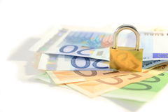 Padlock and money. Isolated on white background.Money security and protection concept Royalty Free Stock Photos