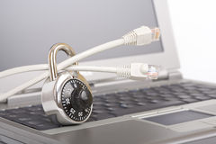 Padlock on network cables Stock Image
