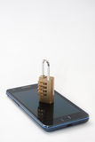 Padlock with number combination on the mobile phone Stock Photos