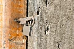 Padlock on an old door Stock Photography