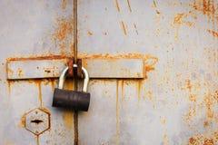 Padlock on the old garage door Stock Photos