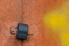 Padlock on the old garage door Royalty Free Stock Photography