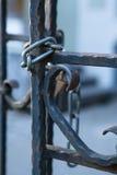 Padlock old iron gate Stock Photo