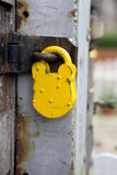 Padlock on the old metal gate Stock Photos