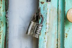 A padlock of the old style on the gate. royalty free stock images