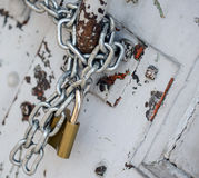 Padlock on old wood door Stock Photos