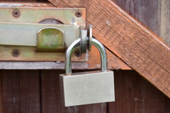Padlock on an old wooden door Stock Image