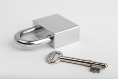 Padlock and one key Stock Photos