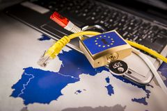 Padlock over a laptop and a EU map, GDPR metaphor. Padlock and net cable over a laptop and a EU map, symbolizing the EU General Data Protection Regulation or Royalty Free Stock Image