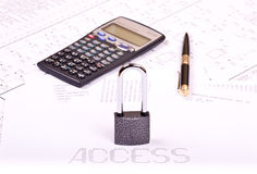 Padlock, pen, calculator Royalty Free Stock Photos