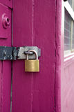 Padlock on pink door Royalty Free Stock Photo