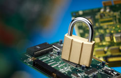 Padlock and printed circuit board Stock Photography
