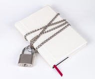 Padlock protects the book in a concept on protect the secret inf Stock Photos