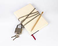 Padlock protects the book in a concept on protect the secret inf Royalty Free Stock Photos