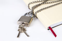 Padlock protects the book in a concept on protect the secret inf Royalty Free Stock Images