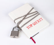 A padlock protects the book in a concept on protect the top secr Royalty Free Stock Photography