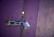 Padlock on purple door Stock Photo