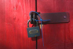 Padlock on red wooden background Stock Photos
