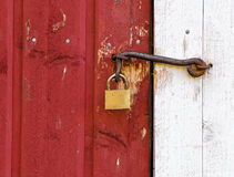 Padlock and a rusty hook Stock Photography