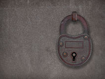 Padlock on a rusty steel plate royalty free stock photography