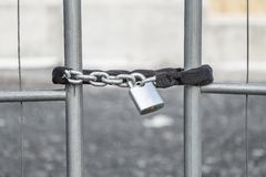 A padlock securing the gate stock images