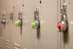 Padlock Security on a School Locker. A colorful row of combination locks on lockers Royalty Free Stock Image