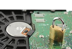 Padlock sitting on computer hard disk drive Royalty Free Stock Photo
