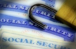 Padlock on top of United States identification document social security card Royalty Free Stock Photos