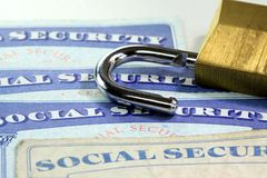 Padlock and social security card - Identity theft and identity protection concept Stock Photos