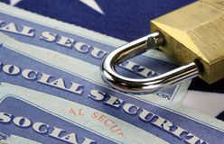 Padlock and social security card - Identity theft and identity protection concept Royalty Free Stock Images