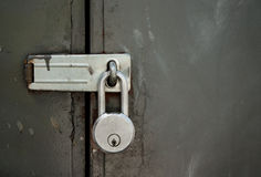 Padlock on a Steel Door Royalty Free Stock Photos
