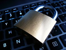 Padlock on top of backlit keyboard Stock Photography