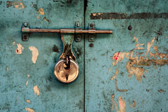Padlock on turquoise background Stock Image