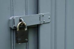 Padlock on wooden door Stock Photo