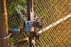 Padlock on wire fence Stock Photography