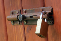 Padlock on wood Stock Images