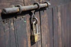 Padlock,  wood door with metal locked Stock Photo