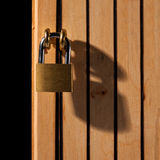 Padlock on wooden door Stock Photo