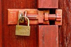 Padlock on wooden door Stock Photography