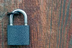 Padlock on a wooden door Stock Images